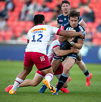 4th June 2021; AJ Bell Stadium, Salford, Lancashire, England; English Premiership Rugby, Sale Sharks versus Harlequins;  AJ MacGinty of Sale Sharks is tackled by Ben Tapuai of Harlequins