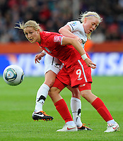 Betsy HAssett (l) of team New Zealand and Ellen White of team England during the FIFA Women's World Cup at the FIFA Stadium in Dresden, Germany on July 1st, 2011.