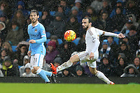 David Silva and Leon Britton during the Barclays Premier League Match between Manchester City and Swansea City played at the Etihad Stadium, Manchester on 12th December 2015