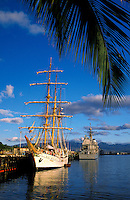 The old meets the new as a vintage sailing vessel from South America moors in the modern navy port of Pearl Harbor.