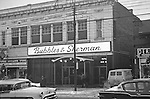 Pittsburgh PA - View of the Forbes Avenue business district near the bluff in Pittsburgh and the famous Bubbles and Sherman restaurant. Other stores on the block; Forbes Hardware Store, Klyne's Clothing Store, Oliver Flower Shop, and Hanna Chapeaux