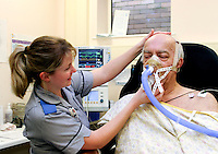Nurse monitoring patient for heart attack in Accident & Emergency Department.