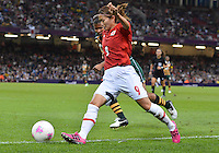 July 31, 2012..Japan's Mizuho Sakaguchi (6) makes a move on South African defender during Football match between JPN and RSA at the Millennium Stadium on day four of 2012 Olympic Games in Cardiff, United Kingdom...