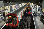 District Line trains at Aldgate East tube station, London..