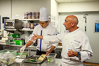 Marina Bay Sands' Executive Chef Christopher Christie gives intructions to chefs and assistants in the resort hotel's kitchen.