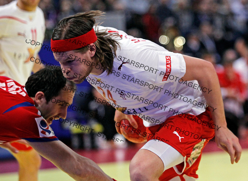 Mikkel Hansen (R) of Denmark in action during men`s EHF EURO 2012 handball championship final game between Serbia and Denmark in Belgrade, Serbia, Sunday, January 29, 2011.  (photo: Pedja Milosavljevic / thepedja@gmail.com / +381641260959)