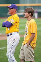 LSU Tigers Head Coach Paul Mainieri (1) with his son before Game 10 of the NCAA College World Series against the TCU Horned Frogs on June 18, 2015 at TD Ameritrade Park in Omaha, Nebraska. TCU defeated the Tigers 8-4, eliminating LSU from the tournament. (Andrew Woolley/Four Seam Images)