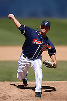J. D. Davis #26 of the Cal State Fullerton Titans pitches against the Texas A&M Aggies at Goodwin Field on March 10, 2013 in Fullerton, California. (Larry Goren/Four Seam Images)