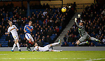 Goslkeeper Mark Brown saves from Lee Wallace