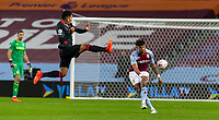 4th October 2020, Villa Park, Birmingham, England;  Aston Villas Tyrone Mings clears the ball under pressure from Liverpools Roberto Firmino during the English Premier League match between Aston Villa and Liverpool at Villa Park