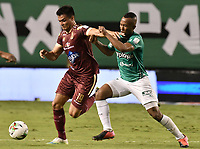 PALMIRA - COLOMBIA, 31-10-2020: Andres Balanta del Cali disputa el balón con Francisco Rodriguez del Tolima durante partido entre Deportivo Cali y Deportes Tolima por la fecha 17 de la Liga BetPlay DIMAYOR 2020 jugado en el estadio Deportivo Cali de la ciudad de Palmira. / Andres Balanta of Cali vies for the ball with Francisco Rodriguez of Tolima during match between Deportivo Cali and Deportes Tolima for the date 17 as part of BetPlay DIMAYOR League 2020 played at Deportivo Cali stadium in Palmira city.  Photo: VizzorImage / Gabriel Aponte / Staff