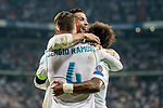 Sergio Ramos (l) of Real Madrid celebrates with teammates Marcelo Vieira Da Silva (r) and Cristiano Ronaldo during the UEFA Champions League 2017-18 match between Real Madrid and APOEL FC at Estadio Santiago Bernabeu on 13 September 2017 in Madrid, Spain. Photo by Diego Gonzalez / Power Sport Images