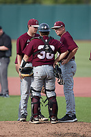 Bellarmine Knights head coach Larry Owens (right) has a meeting on the mound with relief pitcher Anthony Ethington (35) and catcher Patrick Arndt (38) during the game against the Liberty Flames at Liberty Baseball Stadium on March 9, 2021 in Lynchburg, VA. (Brian Westerholt/Four Seam Images)