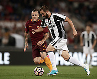 Calcio, Serie A: Roma, stadio Olimpico, 14 maggio 2017.<br /> AS Roma's Gonzalo Higuain (r) in action with AS Roma's Radja Nainggolan (r) during the Italian Serie A football match between AS Roma and Juventus at Rome's Olympic stadium, May 14, 2017.<br /> UPDATE IMAGES PRESS/Isabella Bonotto