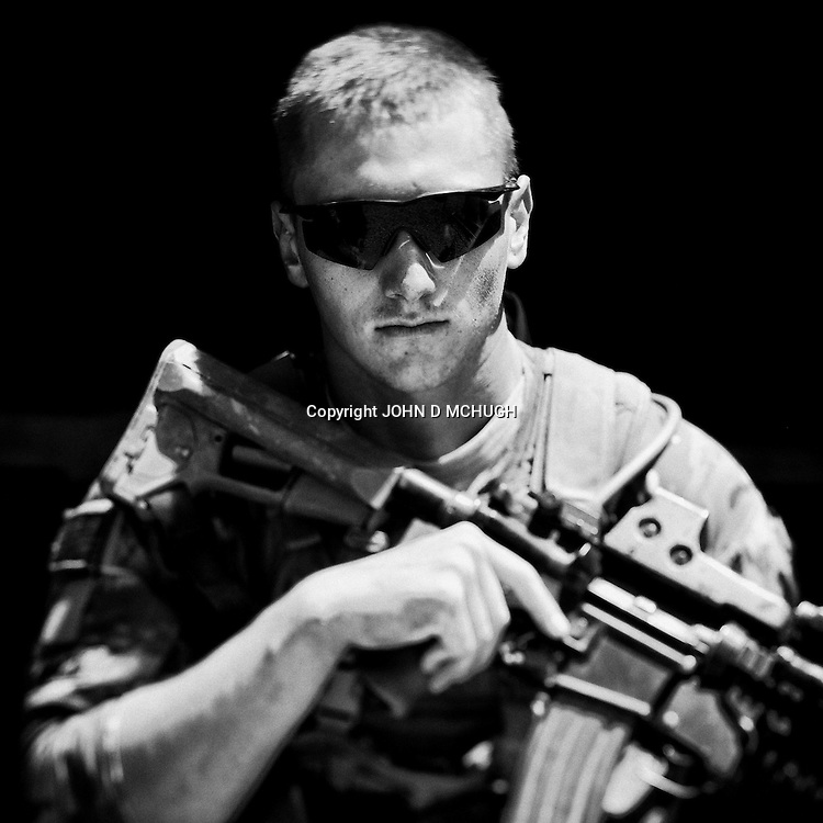 PFC Wallace from 1 Platoon, Delta Co, 1-66, 4th Infantry Division, is seen at Combat Outpost TJ in the Arghandab Valley, Kandahar, 03 May 2011. (John D McHugh)