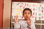 Preschool Headstart 3-5 year olds girl holding up four fingers to show how old she is horizontal