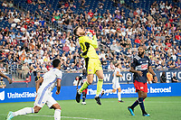 FOXOBOROUGH, MA - AUGUST 21: Matt Turner #30 of New England Revolution leaps to retrieve a high shot on goal during a game between FC Cincinnati and New England Revolution at Gillette Stadium on August 21, 2021 in Foxoborough, Massachusetts.