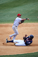 Richmond Flying Squirrels shortstop Ali Castillo (7) turns a double play as Maikis De La Cruz (11) slides in during a game against the Binghamton Mets on June 26, 2016 at NYSEG Stadium in Binghamton, New York.  Binghamton defeated Richmond 7-2.  (Mike Janes/Four Seam Images)