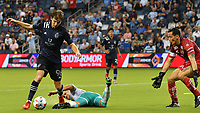 KANSAS CITY, KS - AUGUST 10: Wilson Harris #96 of Sporting Kansas City  tries fire off a shot as Rodolfo Cota #30 of Club Leon FC keeps his cool during a game between Club Leon FC and Sporting KC at Children's Mercy Park on August 10, 2021 in Kansas City, Kansas.