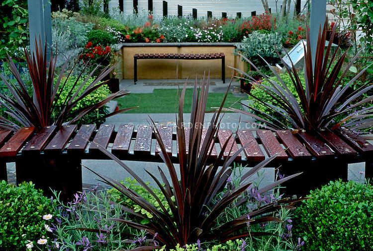 Wooden garden benches in backyard setting #22462