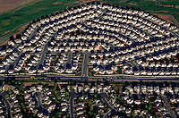 Aerial of a new neighborhood built on former prairie. Colorado.