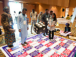 26 June, 2018, Kuala Lumpur, Malaysia : Players throw dice while playing the Child Marriage board game during a session in The Village on the second day at the Girls Not Brides Global Meeting 2018 at the Kuala Lumpur Convention Centre. Picture by Graham Crouch/Girls Not Brides