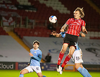Lincoln City's Harry Anderson wins a header under pressure from Manchester City U21's Callum Doyle, and Adrian Berbnabe, left<br /> <br /> Photographer Andrew Vaughan/CameraSport<br /> <br /> EFL Papa John's Trophy - Northern Section - Group E - Lincoln City v Manchester City U21 - Tuesday 17th November 2020 - LNER Stadium - Lincoln<br />  <br /> World Copyright © 2020 CameraSport. All rights reserved. 43 Linden Ave. Countesthorpe. Leicester. England. LE8 5PG - Tel: +44 (0) 116 277 4147 - admin@camerasport.com - www.camerasport.com