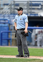 Umpire Matt Carlyon during the first game of a doubleheader between the Connecticut Tigers and Batavia Muckdogs on July 20, 2014 at Dwyer Stadium in Batavia, New York.  Connecticut defeated Batavia 5-3.  (Mike Janes/Four Seam Images)