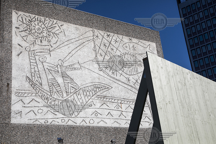 """In the late 1950s and the early 1970s the Spanish artist Pablo Picasso designed five murals (The Beach, The Seagull, Satyr and Faun and two versions of The Fisherman) for the Regjeringskvartalet ('Government quarter') buildings in central Oslo, Norway.<br /> <br /> The designs by Picasso were executed in concrete by Norwegian artist Carl Nesjar, and were Picasso's first attempt at monumental concrete murals<br /> <br /> The modernist building, the Y-block, which formed part of the Norwegian government quarter for over fifty years.  <br /> <br /> The building was drawn by architect Erling Viksjø  and was finished 1969. Following the 2011 terror attack the building was left empty while the government have been mulling its' options. <br /> <br /> A decision on the fate of the murals was expected in early 2014. The murals were subsequently listed as one of Europe's most endangered heritage sites in 2015 by the heritage organisation Europa Nostra following the Norwegian cabinet's vote to demolish the Y-block building.<br /> <br /> In the beginning of 2020 the Norwegian government decided to tear down the building and redevelop the goverment quarter. <br /> <br /> The Architect's Newspaper writes: <br /> """"Demolition-ready government officials have vowed to save and relocate the murals, which were executed by Picasso's frequent collaborator, the Norwegian artist Carl Nesjar. Preservationists near and far, however, are crying foul. They believe that the building itself should also be spared from the wrecking ball.""""<br /> <br /> <br /> <br /> <br /> ©Fredrik Naumann/Felix Features"""