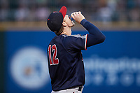 Nashville Sounds third baseman Zach Green (12) pours sunflower seeds into his mouth during the game against the Charlotte Knights at Truist Field on June 4, 2021 in Charlotte, North Carolina. (Brian Westerholt/Four Seam Images)