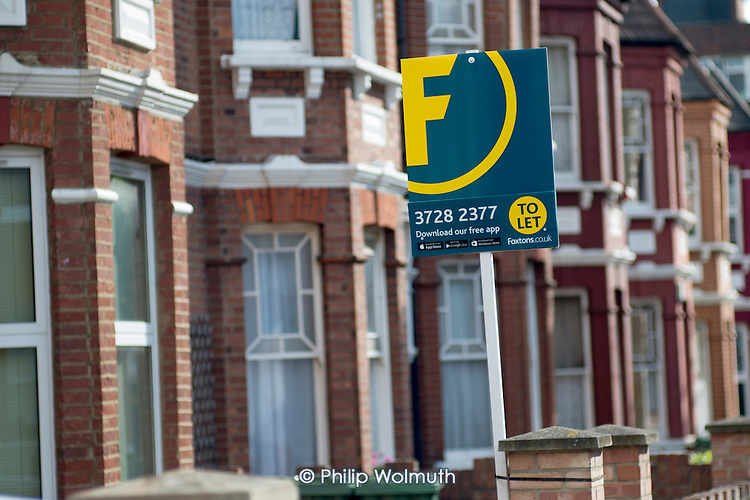 Foxtons estate agent boards, Cricklewood, London.
