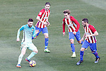 Atletico de Madrid's Gabi Fernandez (c-l), Antoine Griezmann (c-r) and Koke Resurrecccion (r) and FC Barcelona's Leo Messi during La Liga match. February 26,2017. (ALTERPHOTOS/Acero)