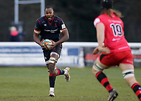 Tjiuee Uanivi of London Scottish brings the ball forward during the Greene King IPA Championship match between London Scottish Football Club and Jersey at Richmond Athletic Ground, Richmond, United Kingdom on 16 December 2017. Photo by Mark Kerton / PRiME Media Images.