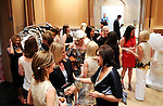 Guests chat and browse the fashions at a cocktail party at the home of Becca Cason Thrash featuring a trunk show from Christos Garkinos, owner of the L.A. boutique Decadestwo Wednesday April 21,2010.. (Dave Rossman Photo)