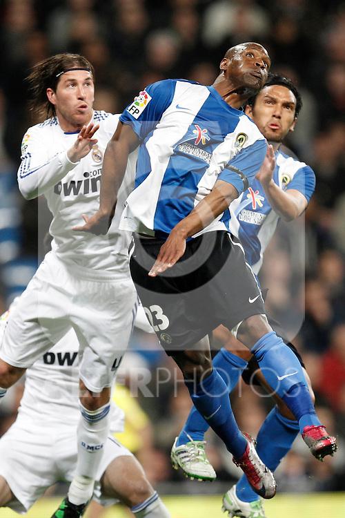Real Madrid's Sergio Ramos and Hercules' Noe Pamarot during la liga match on March 12, 2011...Photo: Cesar Cebolla / ALFAQUI