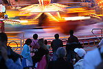 A carnival ride is a swirl of color as dusk falls during Oktoberfest in Munich, Germany. Oct. 2, 2007.