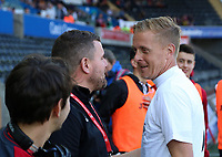 Garry Monk (R) greets Gareth Vincent during the Alan Tate Testimonial Match, Swansea City Legends v Manchester United Legends at the Liberty Stadium, Swansea, Wales, UK