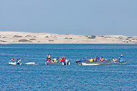gray watchers crowd an adult California Gray gray (Eschrichtius robustus) surfacing in Magdalena Bay near Puerto Lopez Mateos on the Pacific Ocean side of the Baja Peninsula, Baja California Sur, Mexico. Each winter thousands of California gray whales migrate from the Bering and Chukchi seas to breed and calf in the warm water lagoons of Baja. This is the furthest sout of the three major such lagoons. Current (2008) population estimates put the California Gray gray at between 20,000 and 24,000 animals.