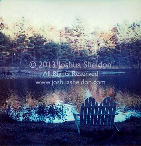 Adirondack chair overlooking lake<br />