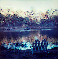 Adirondack chair overlooking lake<br />