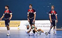 02 NOV 2011 - LONDON, GBR - Israel's Chen Pomeranz (on floor in  white) waits for the referee's decision as Britain's Sebastian Prieto (left) appeals watched by team mates Steve Larsson (centre top) and Mark Hawkins (right) during the Men's 2013 World Handball Championship qualification match at the National Sports Centre at Crystal Palace (PHOTO (C) NIGEL FARROW)