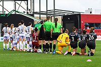BRIDGEVIEW, IL - JUNE 26: Racing Louisville FC Starting XI and Chicago Red Stars Starting XI on lineup on the field for the national anthem before a game between Racing Louisville FC and Chicago Red Stars at SeatGeek Stadium on June 26, 2021 in Bridgeview, Illinois.