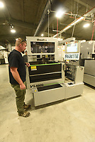 Guy Joubert with Wilson Combat gun makers shows Wednesday July 14 2021 one of several new parts-making machines added after a major expansion of the company south of Berryville. <br />(NWA Democrat-Gazette/Flip Putthoff)