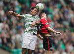 Celtic v St Johnstone...21.09.13      SPFL<br /> Virgil Van Dijk outjumps Steven MacLean<br /> Picture by Graeme Hart.<br /> Copyright Perthshire Picture Agency<br /> Tel: 01738 623350  Mobile: 07990 594431