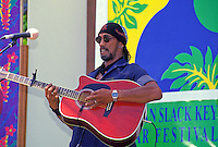Cyril Pahinui performing on stage at the Hawaiian slack key guiter festival