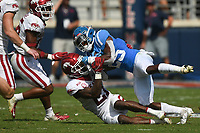 Arkansas defensive back Montaric Brown (21) blocks Ole Miss running back Henry Parrish Jr. (25), Saturday, October 9, 2021 during the third quarter of a football game at Vaught Hemingway Stadium in Oxford, Miss. Check out nwaonline.com/211010Daily/ for today's photo gallery. <br /> (NWA Democrat-Gazette/Charlie Kaijo)