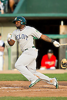 Rashun Dixon (12) of the Beloit Snappers follows through on his swing against the Lansing Lugnuts at Cooley Law School Stadium on May 5, 2013 in Lansing, Michigan.  The Lugnuts defeated the Snappers 5-4.  (Brian Westerholt/Four Seam Images)