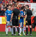 Andy Halliday has words with the ref at the end