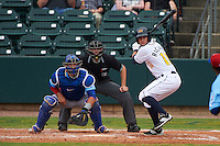 Montgomery Biscuits outfielder Joey Rickard (10) at bat in front of catcher Kyle Schwarber and umpire Alex Ransom during a game against the Tennessee Smokies on May 25, 2015 at Riverwalk Stadium in Montgomery, Alabama.  Tennessee defeated Montgomery 6-3 as the game was called after eight innings due to rain.  (Mike Janes/Four Seam Images)