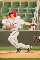 Brandon Miller (20) of the Hagerstown Suns follows through on his swing against the Kannapolis Intimidators at CMC-Northeast Stadium on May 17, 2013 in Kannapolis, North Carolina.  The Suns defeated the Intimidators 9-7.   (Brian Westerholt/Four Seam Images)